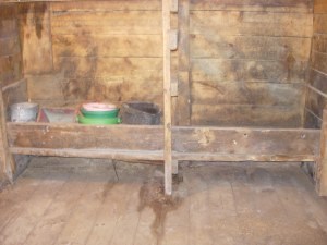 clean stall, troughs ready.